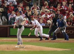 Carlos Beltran of the Cardinals watches his two-run double off Dodgers starter Zack Greinke in Game 1 of the National League Championship Se...
