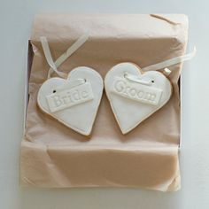 Bride & Groom Cookies by NilaHolden on Etsy, £15.00  I purchased and have had NIla's cookies and they are as delicious as they are beautiful!