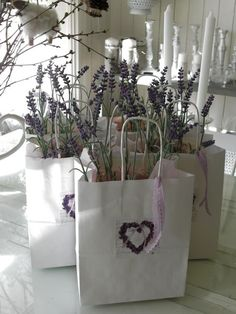 Perfect favor-lavender plant in hand-decorated gift bag