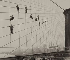 Painters on the Brooklyn Bridge Suspender Cables-October 7, 1914 by Eugene de Salignac   from MoPA