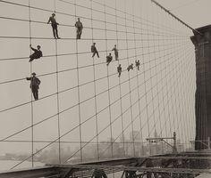 Painters on the Brooklyn Bridge Suspender Cables-October 7, 1914 byEugene de Salignac  fromMoPA