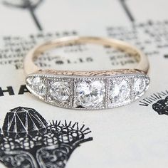 This c1915 ring has an incredible presence. The five transitional-cut diamonds are bead-set in 18k white gold, with stones that graduate from .09ct to .13ct to .39ct and back down again for an approximate total of .83ctw.  $4000.