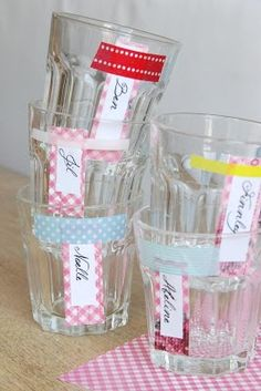Washi tape with personalized name tags on cups...kraft tags and stamped names would be cute!