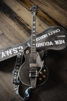 old black guitar - antiquity