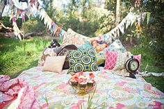 I like the use of bright colours and rug. The pillows create a feel of laziness that picnics often have. --- Cakesandmupies.blogspot.com. 2012. [i]The Styled Engagement Shoot[/i], Available: http://www.cakesandmudpies.blogspot.com.au/2012/04/styled-engagement-shoot.html (Accessed: 23 March 2014)