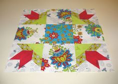 """A traditional quilt block pattern published by the Kansas City Star in 1930 called """"Sage Bud.""""   It is also known as """"Mexican Star.""""  Pieced by Pam Wilson in January 2015."""