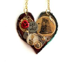 This necklace is one-of-a-kind. It measures approximately 1.7 across and features antique gears, BAD WOLF graffiti, a red rose for Rose Tyler,