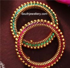 22 Carat gold bangles studded with rubies on one side and emerald on the other side by Talwar Jewellers. Two sided gold bangles, double sided bangles Indian Jewellery Design, Indian Jewelry, Jewelry Design, Diamond Jewelry, Gold Jewelry, Jewelery, Talwar Jewellers, 22 Carat Gold, Gold Bangles Design