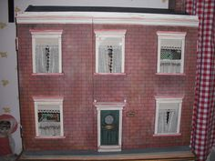 Gibson House.This was an old dolls house with the front missing. I designed and made the front.....done for a good friend.