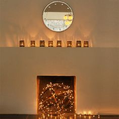 Fairylights used in the fireplace when fire isn't needed! Gorgeous ...