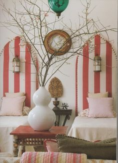 red stripe head boards- love the built in sconces!