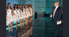 The 2009 Miss Universe contestants take a break in rehearsals to meet Donald Trump in the Imperial Ballroom at Atlantis, Paradise Island Bahamas on August 21, 2009.