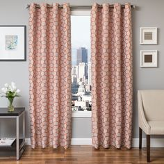 This product features a Jacquard geometric weave and is a perfect contemporary piece.  Made of 100% polyester, the curtain panels are finished with a Grommet top for easy hanging.