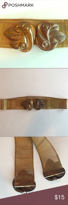 """Vintage gold metal waist belt Vintage gold waist belt with scroll and leaf clasp. Belt is made of a metal mesh and has some tarnish on both the mesh and the clasps. Width is 29.5"""" and is not super stretchy. Likely from the 70s, I have never worn it but the original owner did! Purchased at an estate sale ten years ago. Accessories Belts"""