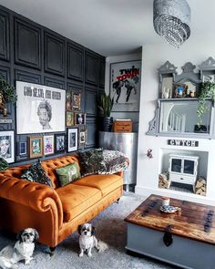 what an amazing living room love the burnt orange sofa against the dark panelled wall