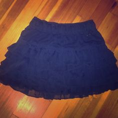 NWOT Navy blue ruffle skirt Elegant skirt, elastic waistband. Tiered. Would be super cute with a white tank and necklace  Hollister Skirts Midi