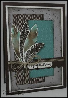 Stampin' Up - color stamp with markers then spritz with water before stamping to get that great watercolor look. Four Feathers and Gorgeous Grunge stamps; Trim the Tree DSP; Early Espresso, Lost Lagoon, Smoky Slate, and Whisper White ink and card stock.