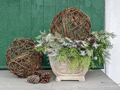 To create a simple but high impact outdoor holiday display, try these lighted grapevine spheres. They're a great way to fill front porch urns that have been left empty once the summer and fall flowers fade.
