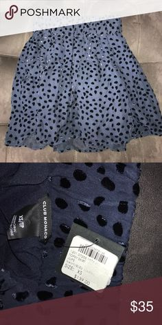 Club Monaco Skirt Navy blue skirt; elastic at waste; velour printed polka dots; beautiful skirt for work or date night! even a casual outfit! never worn tags still attached Club Monaco Skirts Mini