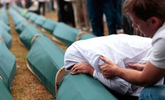 A Bosnian Muslim woman cries on the coffin of a relative during a mass funeral for victims killed during 1992-1995 war in Bosnia, whose remains were found in mass graves around the town of Prijedor and Kozarac, 50 km (31 miles) northwest of Banja Luka. (Reuters)
