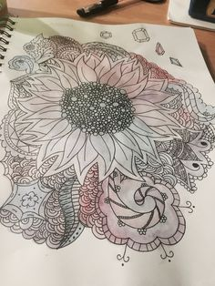 To make this zentangle, I started by drawing a variety of patterns in pencil. Once it was drawn out, I went over it with a light coat of watercolor, then I finished by lining it in black ink.