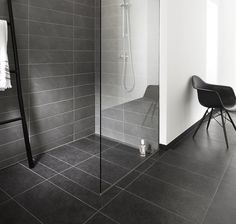 Beautiful and elegant GlassLine shower screen, with linear floor drain with a floor tile that matches the rest of the bathroom floor. unidrain®: GlassLine & HighLine