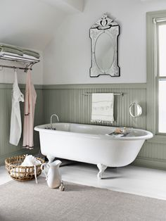 Bathroom Decorating and Design Ideas - Country Bathroom Decor - Country Living - gorgeous beveled mirror, nice wainscot, clawfoot tub