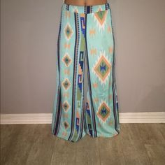 Pant Fun pattern pants very wide leg and long! Elastic band makes it looked like I have them rolled but they are not! Only worn a few times! Pants