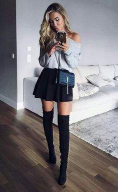 Bkack mini skirt + over the knee black boots + off the shoulder grey sweater + teal crossbody bag