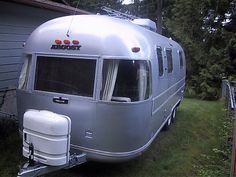 I bought me one of these today!  Mine is a 1977, 28 ft.  The only difference is mine is painted cream colored.  Really cool!  It is a project as the inside needs updating...but structurally it is sound.  I'm excited!  I love renovating and decorating!