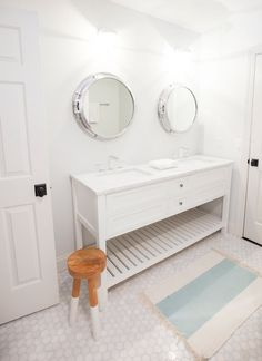 Cottage kids' bathroom features side-by-side porthole mirrors over white double washstand topped . Porthole Mirror, Boy Bath, Nautical Bathrooms, Laundry In Bathroom, Bathroom Inspiration, Bathroom Ideas, Maine House, Bathroom Styling, Beautiful Bathrooms