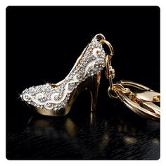 Crystal Bling Silver Stiletto Purse Charm/Keychain 👠 Silver rhinestone stiletto high heel shoe keychain. Beautifully designed with gold tone metal, white enamel & detailed with sparkling silver Crystal bling. Includes a key ring and a secure lobster clasp, perfect for use as a keychain or purse charm.  Features: Chain Metal: Zinc Alloy Stone: Rhinestone Crystal Measurements: Charm: 1.5 in. x 1.5 in. Chain: 2.5 in. x 1.25 in. Total Measurements: 4 in. x 2 in.  Many available, contact me to…