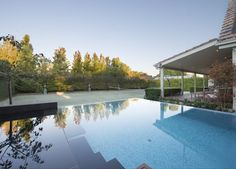 OFTB Melbourne landscape architecture, pool design & construction project - wet edge pool, bisazza glass mosaic tile, spotted gum decking, bluestone paving