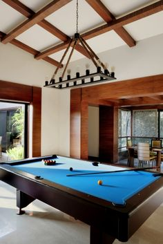 This spacious game room has a rustic feel to it, with its wooden beams and rope chandelier. (scheduled via http://www.tailwindapp.com?utm_source=pinterest&utm_medium=twpin&utm_content=post32959476&utm_campaign=scheduler_attribution)
