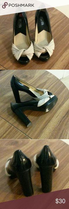 MICHAEL Michael Kors Leather Upper Pumps Cream and Black color Leather Upper Rubber outsole peep toe Pumps. In EUC, light signs of wear. 5.5inches heels 7.5M Michael Kors Shoes Heels