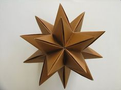 In this video tutorial, I will show you how to make an origami Modular Decorative Star Ball. Enjoy :D! Origami: 3D Omega Star Designed By: John Montroll Made By: Suhas Sunder