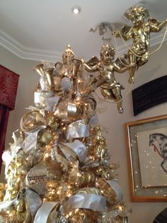 Gold Christmas tree with cherub toppers Exquisite professional Christmas decor by Nicholas Christmas Luxury Christmas Tree, Beautiful Christmas Trees, Christmas Mantels, Elegant Christmas, Christmas Holidays, Christmas Tree Decorations, Frontgate Christmas Trees, Christmas Tree Toppers, Shabby