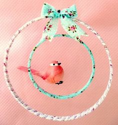 Swinging bird in two hoops with ribbon
