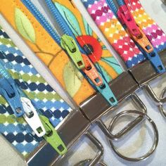 Tip: Add color to your zipper project by using more than one zipper pull. Use Joan's 'Easy On' trick in the Fobio pattern to add more than one zipper pull to your next project. All of the pulls work, but they are decorative, too. Lazy Girl Designs