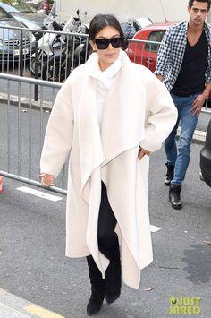 Kim Kardashian wearing Maison Martin Margiela Long Suede Covered Heel Boots and Chloe Double-Faced Alpaca-Blend Coat.
