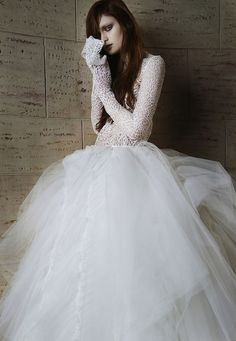 This lace and tulle ball gown style wedding gown has us swooning. Vera Wang has brought thoughts of fairytale princess to mind with her iconic style.
