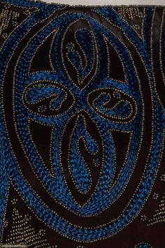 1920s black chiffon tunic w/ blue floss embroidery & dull gold beads, asymmetrical hem. Detail