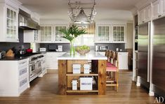 Hank Azaria's kitchen. Loving the classic and the rustic blended with modern refinements.