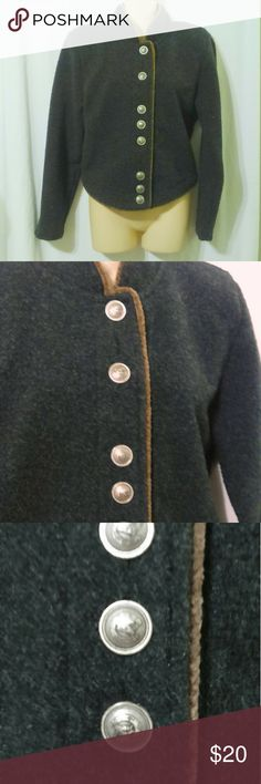 """County Clothing Co Cheyenne Collection Blazer This lovely equestrian styled jacket is made by County Clothing Company's Cheyenne Collection. It is done in an acrylic polyester blend in a charcoal gray with brown piping. The jacket buttons with silver metal buttons with horses on them (tried to get pics but not sure how well they turned out!). Measurements are: Bust 40"""", waist 36"""", sleeves 24"""", length 18"""". In beautiful condition! County Clothing Co Jackets & Coats"""