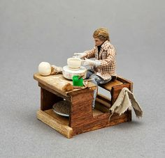 Craig Roberts: Hand-turned Pottery [in miniature] & More: Male potter working on a potter's wheel.