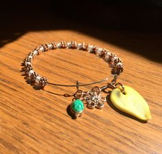 A personal favorite from my Etsy shop https://www.etsy.com/listing/234452215/artisan-and-vintage-love-charm-bracelet