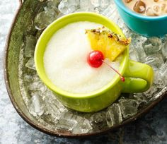 Pina Colada recipe - these easy Freezer Pina Coladas can be prepared in a blender, then conveniently frozen in mugs overnight. When ready, simply remove the lids and enjoy this tropical slushy.