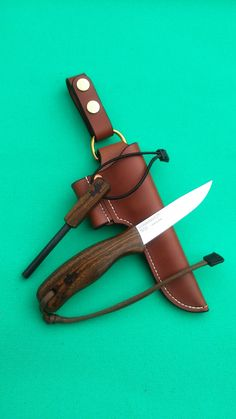 An example of the Bushcraft Knives i make based around the Mora No2 Blade with Wooden handle and a matching Firesteel. Comes with Handmade Leather sheath. The wood in this example is Bocote.