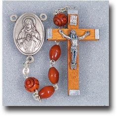 Reginas Catholic Gifts - Oval Genuine Cocoa Beads  Natural with Carved Pater Beads Rosary, $31.95 (http://www.reginascatholicgifts.com/oval-genuine-cocoa-beads-natural-with-carved-pater-beads-rosary/)