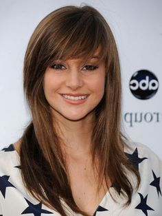 Long Layered Haircut With Bangs - I like how the bangs blend in with the rest of her hair.
